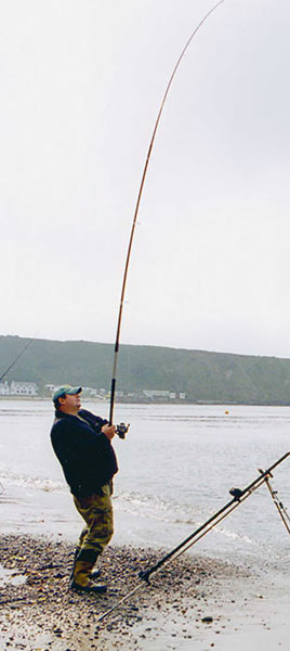 Danny Moeskops Casting on a beach with a Century Sea fishing rod